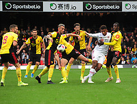 Football - 2019 / 2020 Premier League - Watford vs. Sheffield United<br /> <br /> Lys Mousset of Sheff Utd is outnumbered by the Watford defence Watford  at Vicarage Road.<br /> <br /> COLORSPORT/ANDREW COWIE