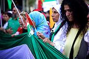 Mainz | 18 July 2014<br /> <br /> Am Samstag (18.07.2014) nahmen etwa 1000 M&auml;nner, Frauen und Kinder in der Innenstadt von Mainz anl&auml;sslich der milit&auml;rischen Auseinandersetzung zwischen Israel und der Hamas in Gaza an einer Solidarit&auml;tsdemonstration f&uuml;r Gaza, ein freies Pal&auml;stina und gegen Israel teil. Bei der Demo wurden Fahnen der Hamas und der Hisbollah mitgef&uuml;hrt, neben den &uuml;blichen Parolen gegen Israel wurde in Sprechch&ouml;hren auch vereinzelt zur Vernichtung von J&uuml;dinnen und Juden aufgerufen.<br /> Hier: Frauen mit Pal&auml;stina-Fahnen.<br /> <br /> <br /> &copy;peter-juelich.com<br /> <br /> [No Model Release | No Property Release]