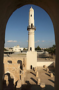 A minaret of the Khamis mosque, an Umayyad mosque possibly founded in the 7th century, originally built in the 11th century and rebuilt in the 14th and 15th centuries, with 2 identical minarets, in Khamis, Manama, Bahrain. This was the first mosque in Bahrain and one of the earliest in the Gulf region. Picture by Manuel Cohen