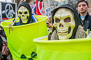 "Human nuclear waste barrels - A CND led national demonstration to protest against Britain's nuclear weapons system: Trident. They state - ""The majority of the British people, including the Labour leader Jeremy Corbyn, oppose nuclear weapons. They are weapons of mass destruction, they don't keep us safe and they divert resources from essential spending."" The march from Hyde park to Trafalgar Square was supported by Friends of the Earth, the Green party, Greenpeace, the PCS Union, the Quakers, the Stop the War Coalition, War on Want amongst amny others."