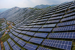 July 5, 2018  - Yuncheng, China - Aerial photo shows a photovoltaic power plant in Ruicheng County of Yuncheng City, north China's Shanxi Province. In recent years, the county has vigorously developed and utilized solar energy by building photovoltaic power plants on barren mountains.  (Credit Image: © Cao Yang/Xinhua via ZUMA Wire)