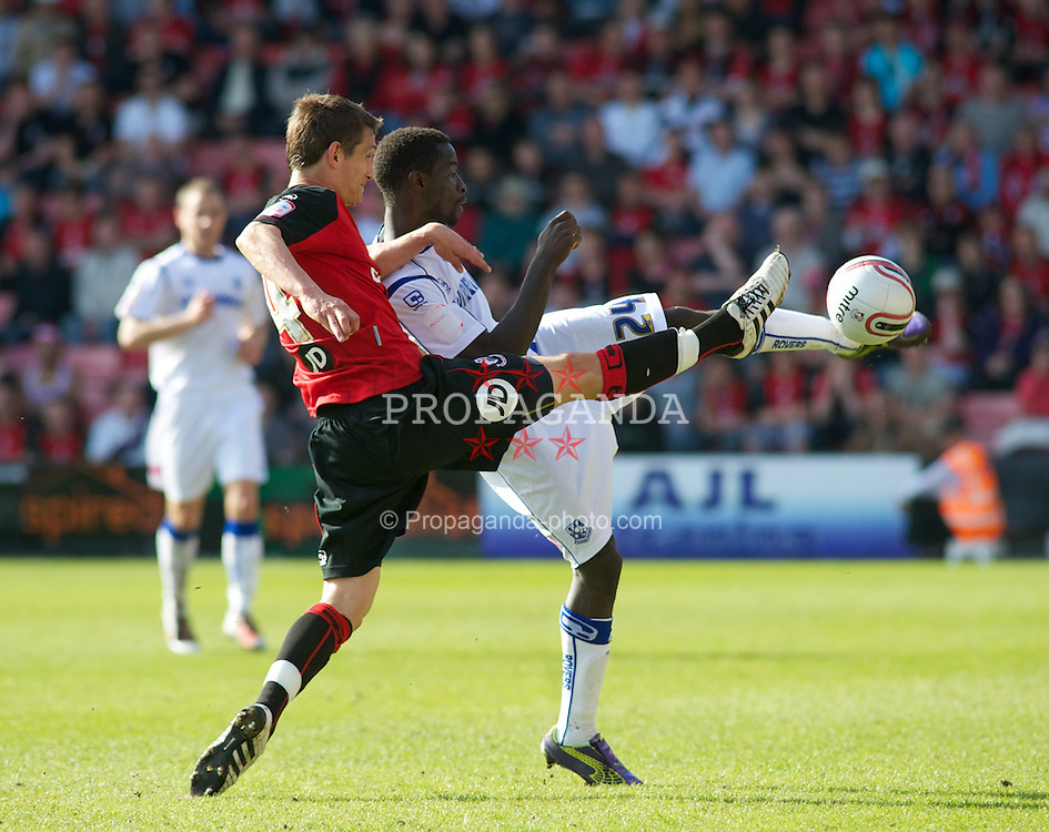 BOURNEMOUTH, ENGLAND - Saturday, April 9, 2011: Tranmere Rovers' Zoumana Bakayogo and Bournemouth's Shaun Cooper in action during the Football League One match at the Dean Court Stadium. (Photo by Gareth Davies/Propaganda)