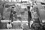Workers set up a fresh produce market in downtown Nairobi. This urban market on a busy street is very busy.