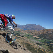 Jarrah Davies from Australia in action during the NZBNZ South Island Downhill Cup mountain bike downhill series held on The Remarkables face with a stunning backdrop of the Wakatipu Basin. 150 riders took part in the two day event.  Queenstown, Otago, New Zealand. 9th January 2012. Photo Tim Clayton