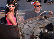 A couple of Rockabillies riding in a Hotrod, 50's style car, Viva Las Vegas Festival, Las Vegas, USA 2006.