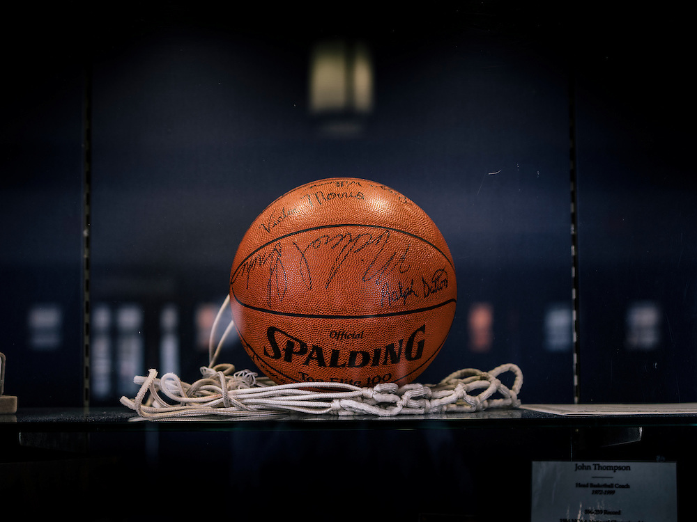 The NCAA championship basketball signed by the entire Georgetown team, including Michael Graham, sits in a case in McDonough Area on the GU campus.