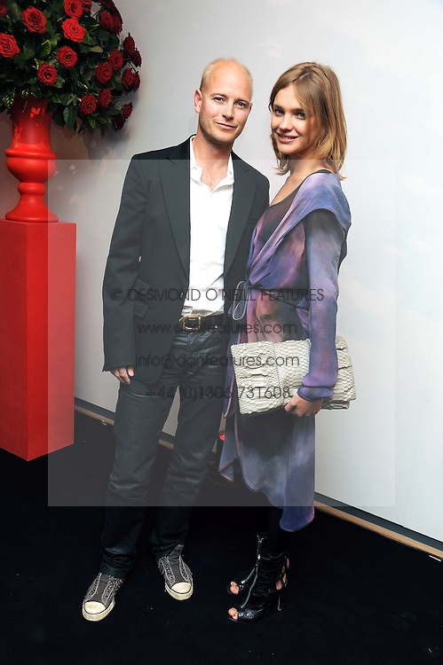 The HON.JUSTIN PORTMAN and his wife NATALIA VODIANOVA at the TAG Heuer British Formula 1 Party at the Mall Galleries, London on 15th September 2008.