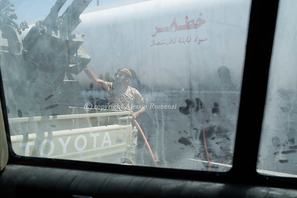 Libya: A Libya's Government of National Accord's (GNA) fighter makes fuel from a tanker in Sirte, Alessio Romenzi