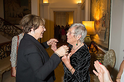Left to right, DELIA SMITH and ANNA DEL CONTE at a reception in honour of Anna del Conte held at The Italian Emabssy, Grosvenor Square, London on 9th November 2015.