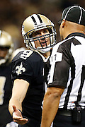 NEW ORLEANS, LA - NOVEMBER 11:  Drew Brees #9 of the New Orleans Saints talks with a official during a game against the Atlanta Falcons at Mercedes-Benz Superdome on November 11, 2012 in New Orleans, Louisiana.  The Saints defeated the Falcons 31-27.  (Photo by Wesley Hitt/Getty Images) *** Local Caption *** Drew Brees