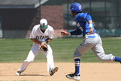 11 April 2015:  Derek Idstein fields a hopper as Julian Gutierrez hustles to 2nd during an NCAA division 3 College Conference of Illinois and Wisconsin (CCIW) Pay in Baseball game during the Conference Championship series between the Millikin Big Blue and the Illinois Wesleyan Titans at Jack Horenberger Stadium, Bloomington IL