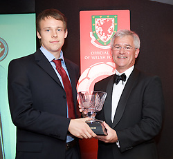 CARDIFF, WALES - Tuesday, October 7, 2008: Wales' Chris Gunter receives the Wales Young Player of the Year award from Stewart Dobson, Head of Marketing at Brains, during the Brains Beer Wales Football Awards at the Millennium Stadium. (Photo by David Rawcliffe/Propaganda)
