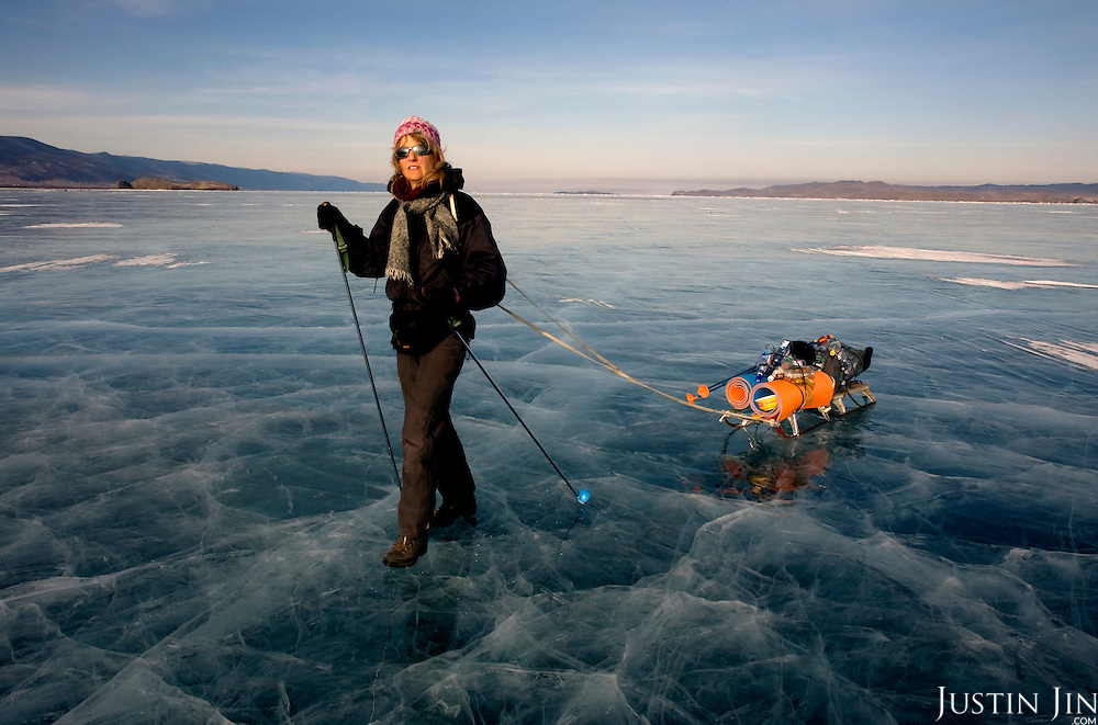 Heleen treks across frozen Lake Baikal in Siberia, Russia, collecting vodka bottles on her way.  (6th day).They are a group of five people: Justin Jin (Chinese-British), Heleen van Geest (Dutch), Nastya and Misha Martynov (Russian) and their Russian guide Arkady. .They pulled their sledges 80 km across the world's deepest lake, taking a break on Olkhon Island. They slept two nights on the ice in -15c. .Baikal, the world's largest lake by volume, contains one-fifth of the earth's fresh water and plunges to a depth of 1,637 metres..The lake is frozen from November to April, allowing people to cross by cars and lorries.