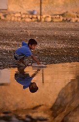 TURKEY HASANKEYF JUL02 - Young children play in a puddle in the old historic city of Hsankeyf, known for its caves and castle. Soon this entire area is to be flooded due to the construction of a new hydroelectric dam further downriver...jre/Photo by Jiri Rezac..© Jiri Rezac 2002..Contact: +44 (0) 7050 110 417.Mobile:  +44 (0) 7801 337 683.Office:  +44 (0) 20 8968 9635..Email:   jiri@jirirezac.com.Web:     www.jirirezac.com
