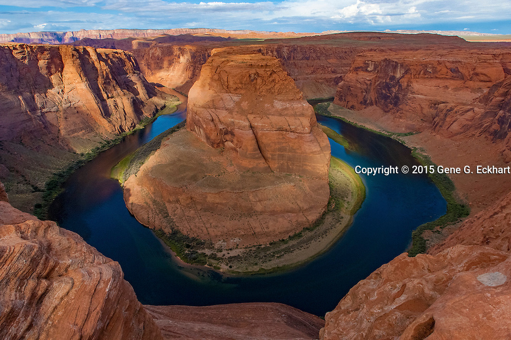 Horseshoe Bend is a horseshoe-shaped meander of the Colorado River located near the town of Page, Arizona, in the United States.  The overlook is 4,200 feet (1,300 m) above sea level, and the Colorado River is at 3,200 feet (980 m) above sea level, making it a 1,000-foot (300 m) drop.  The rock walls of Horseshoe Bend contain a variety of minerals, among which are hematite, platinum and garnet.