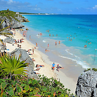 Caribbean Sea Beach at Mayan Ruins in Tulum, Mexico<br /> People who visit the Mayan ruins at Tulum are quickly surprised by the heat. The average, year-round temperature is 88&deg; and the site offers no shade from the intense Mexican sun. So bring your bathing suit. When you get too hot, walk down the staircase, go for a refreshing dip in the Caribbean Sea and then spread your towel on the sandy beach. What a perfect combination: ancient ruins without ruining your sunbathing time.