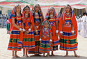Young Indian girls wearing traditional Rajasthani jewellery and veils for a cultural performance in Rajasthan, India