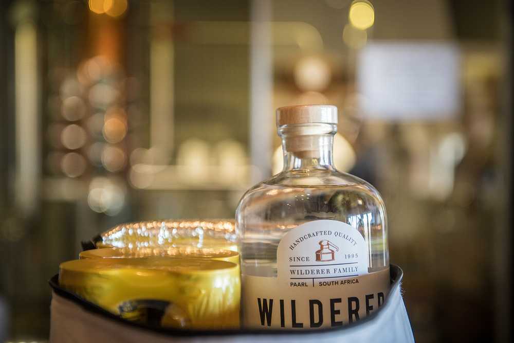 Bottle of handcrafted Gin tucked into bag, Cape Town, South Africa