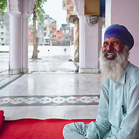 Sikh elderly man at Santokhsar, one of five sarovars (sacred pools) of Amritsar.