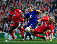 Wayne Rooney of Manchester United is denied by Mohammed Sissoko, left and Sami Hyppia of Liverpool