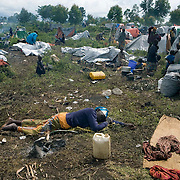 Displaced people seek refuge at the Kibati camp outside of Goma. Fighting escalated in recent weeks between the rebel group CNDP, the National Congress for the Defense of the People, and the Congolese army, displacing tens of thousands of people.
