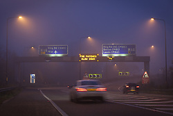 © Licensed to London News Pictures . 06/11/2012 . Manchester , UK . Fog warning signs on overhead gantries above the M60 ring road in Manchester this (6th November 2012) morning . Photo credit : Joel Goodman/LNP