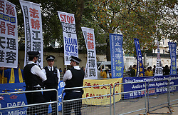 © Licensed to London News Pictures. 20/10/2015. London, UK. Police watch a Falung Dafa protest in The Mall ahead of Chinese President Xi Jinping's four day State Visit to the United Kingdom. Photo credit: Peter Macdiarmid/LNP