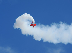 Aerobatic pilot Sean Tucker puts his Oracle Challenger Pitts biplane through a flip at this weekend's California International Airshow Salinas. The exhibition featured state-of-the-art precision flying from the US Air Force Thunderbirds, Canada's CF-18 demonstration team and the civilian Patriots jet team. Both days of the show highlighted aerobatic routines from Tucker, Jacquie Warda and Kent Pietsch, aerial tributes to flying legends Clay Lacy and Bob Hoover, and plenty of static aircraft displays for the whole family.