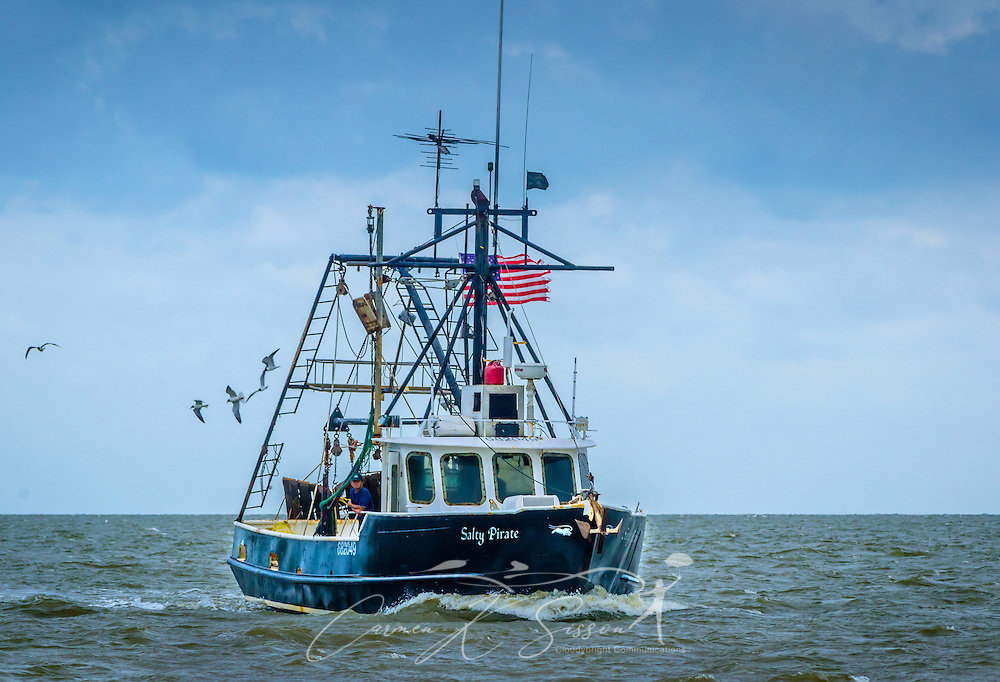 "The Salty Pirate shrimp boat heads home after a long day of shrimping in Bayou La Batre, Alabama, May 16, 2015. Bayou La Batre is known as the ""Seafood Capital of Alabama."" (Photo by Carmen K. Sisson/Cloudybright)"