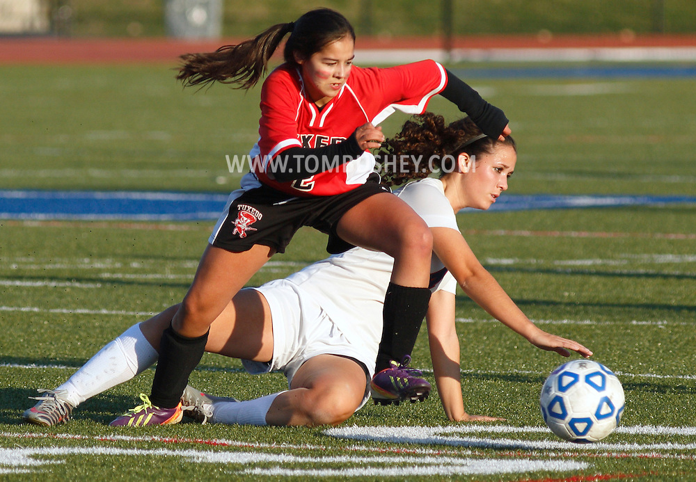 Tuxedo's Cierra Melone (2) races after the ball after S.S. Seward's Alyssa Kamrowski tried to knock the ball away with a sliding tackle during the Section 9 Class C girls' soccer championship game at Faller Field in Middletown on Wednesday, Oct. 30, 2013.