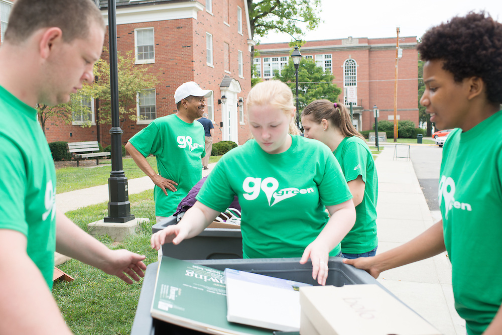 Ohio University President Roderick McDavis (Center Left) and a team of volunteers move students into their residence halls on East Green. Photo by Ben Siegel/ Ohio University