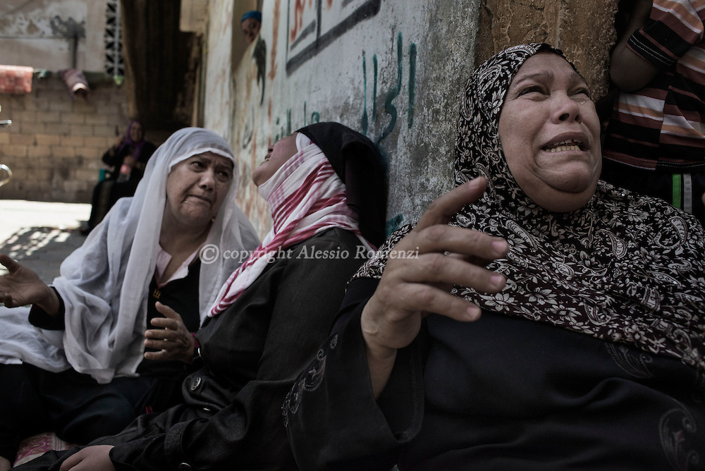 Gaza Strip, Beit Hanun: Relatives of Mohammed Masri (9 yo) react in Beit Hanun (north of Gaza Strip) where he was killed along with his mother by Israeli airstrike on July 9, 2014. ALESSIO ROMENZI