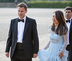 "© Licensed to London News Pictures . Oxfordshire , UK . FILE PICTURE DATED 12/07/2018 of British Foriegn Secretary JEREMY HUNT and his wife LUCIA GUO , at Blenheim Palace , during a visit by US President Donald Trump . Hunt has mistakenly referred to his Chinese wife as ""Japanese"" during an official visit to China . Photo credit: Joel Goodman/LNP"