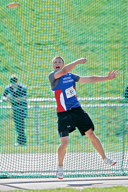 Sherbrooke, Quebec ---09/08/09---  Delling Ingvaldson of Cloverdale, British Columbia throws to victory in the under 17 boys discus at the 2009 Legion Canadian Youth Track and Field Championships in Sherbrooke, Quebec, August 09, 2009. Ingvaldson won with a throw of 51.19 metres..HO/ Athletics Canada (credit should read GEOFF ROBINS/Mundo Sport Images/ Athletics Canada)..