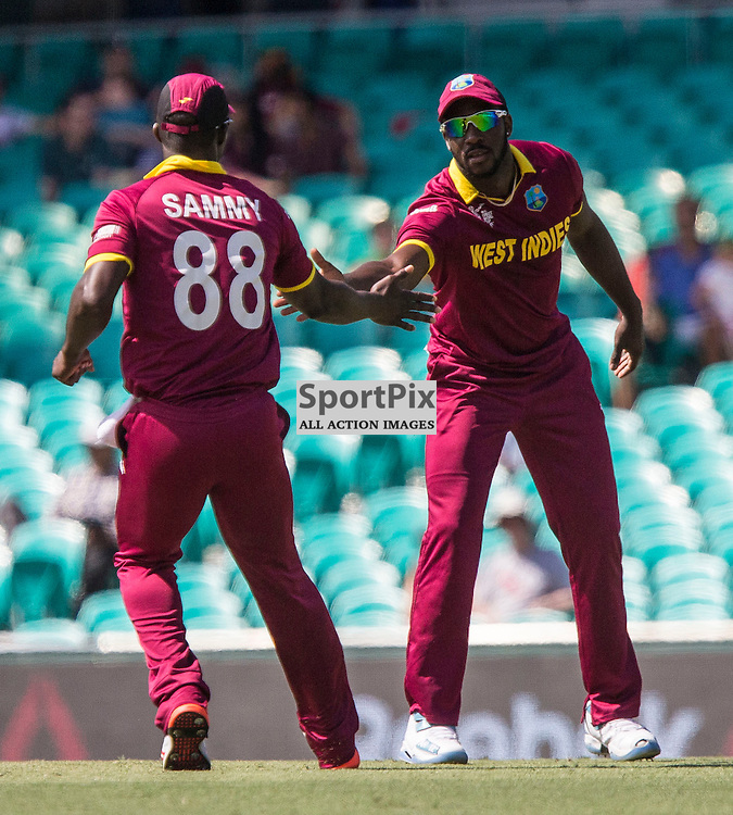 ICC Cricket World Cup 2015 Tournament Match, South Africa v West Indies, Sydney Cricket Ground; 27th February 2015<br /> West Indies Darren Sammy congratulates West Indies Jason Holder for stopping a ball