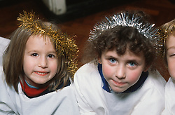 Nursery school children dressed up as angels for nativity play,
