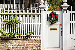 December 21, 2017 - Charleston, South Carolina, United States of America - A garden garden gate decorated with a Christmas wreath on a historic home at Legare Street in Charleston, SC. (Credit Image: © Richard Ellis via ZUMA Wire)