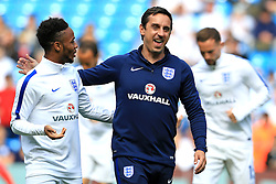 Raheem Sterling jokes with England coach Gary Neville before kick off - Mandatory byline: Matt McNulty/JMP - 07966386802 - 22/05/2016 - FOOTBALL - Etihad Stadium -Manchester,England - England v Turkey - International Friendly