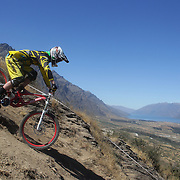 Lloyd Jenks from Wellington in action during the New Zealand South Island Downhill Cup Mountain Bike series held on The Remarkables face with a stunning backdrop of the Wakatipu Basin. 150 riders took part in the two day event. Queenstown, Otago, New Zealand. 9th January 2012. Photo Tim Clayton