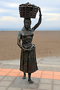 Sculpture of woman carrying full basketon her head, Gran Tarajal, Fuerteventura, Canary Islands, Spain
