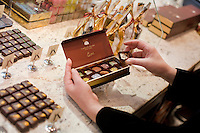 """24 October, 2008. New York, NY. Owner Namhee Girerd Kim, 53, picks an assortment of bon bons and fills a box at the boutique """"L'atelier du chocolat"""". The chocolates are made by her husband, Eric Girerd.<br /> NOTE: Since no customers were at the shop, the subject posed for the photographer.<br /> ©2008 Gianni Cipriano for The New York Times<br /> cell. +1 646 465 2168 (USA)<br /> cell. +1 328 567 7923 (Italy)<br /> gianni@giannicipriano.com<br /> www.giannicipriano.com"""