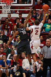 Feb 19, 2012; Stanford CA, USA; Stanford Cardinal guard Aaron Bright (2) is defended by Oregon Ducks guard Johnathan Loyd (10) during the second half at Maples Pavilion. Oregon defeated Stanford 68-64. Mandatory Credit: Jason O. Watson-US PRESSWIRE