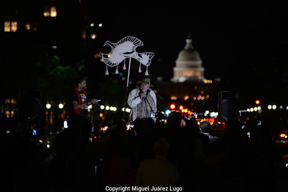 WASHINGTON DC - Sept. 10, 2012: Mexican poet Javier Sicilia and others who've lost loved ones to Mexico's drug war rally in Freedom Plaza, with the U.S. Capitol behind, calling for an end to policies they believe are fueling the violence. Sicilia, whose son was killed in drug-related violence, founded the Caravan for Peace With Justice, a group of Mexican families who have lost loved ones in the drug war and which has traveled across the U.S. this summer. The drug war has killed by some estimates more than 60,000 people since Mexican President Felipe Calderon initiated it nearly six years ago. (PHOTO: MIGUEL JUAREZ LUGO)