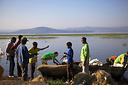 Boys help to fix the fishermen's nets on the shores of Lake Hawassa, Ethiopia.