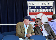 National Baseball Hall of Famers Goose Gossage, left, and Rickey Henderson share a laugh during an awards ceremony at Doubleday Field on Saturday, July 23, 2016, in Cooperstown, N.Y. (AP Photo/Heather Ainsworth)
