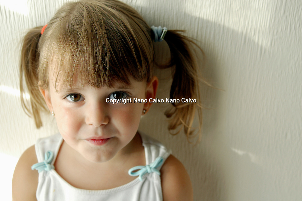 Model released portrait of a three year old girl with two pony tails