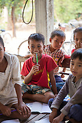 Children of all ages enjoying an English class run by ICS volunteers Luna Boran, Tania Tuzizila, Dan Hensman  & Sokuntheary Nhel  n the village at a host home, in the village of in Banteay Char, near Battambang, Cambodia.