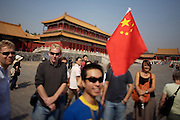 Gugong (Forbidden City, Imperial Palace). Hongyi Ge. Tour guide with Chinese flag.