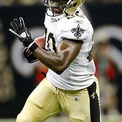 August 12, 2011; New Orleans, LA, USA; New Orleans Saints running back Joique Bell (20) against the San Francisco 49ers during the second half of a preseason game at the Louisiana Superdome. The New Orleans Saints defeated the San Francisco 49ers Mandatory Credit: Derick E. Hingle