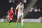 Milton Keynes Dons defender Joe Walsh (4) looks to release the ball during the EFL Sky Bet League 2 match between Milton Keynes Dons and Grimsby Town FC at stadium:mk, Milton Keynes, England on 21 August 2018.